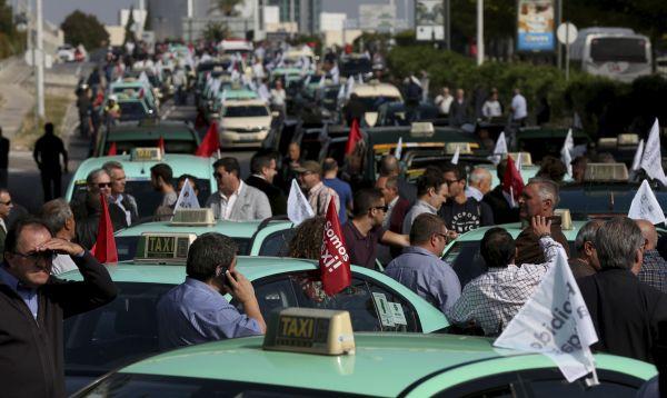 Taxistas generan tráfico en Lisboa en protesta contra Uber - Noticias de empresas